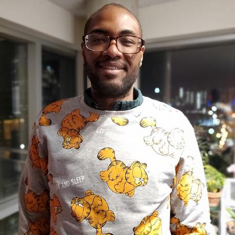 A photo of Joseph Damiba, an African-American male, wearing a Garfield sweater.